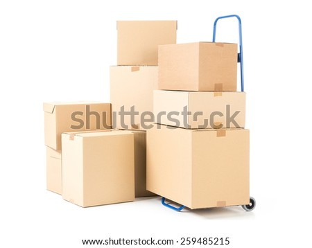 Hand truck and pile of cardboard boxes on white background - stock photo