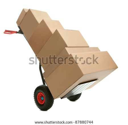 Hand truck with cardboard boxes on it ready for delivery over white background - stock photo