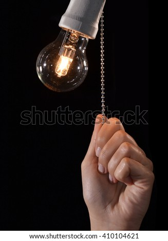 Hand turning off the bulb lamp.Turning off the light. - stock photo