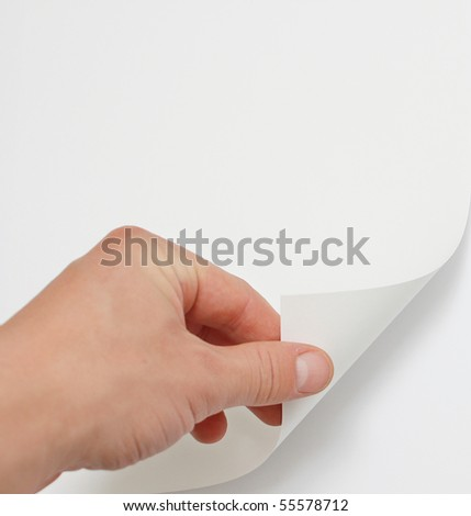 Hand turning page - stock photo
