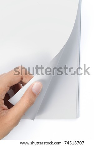 hand turning page of blank cover magazine - stock photo