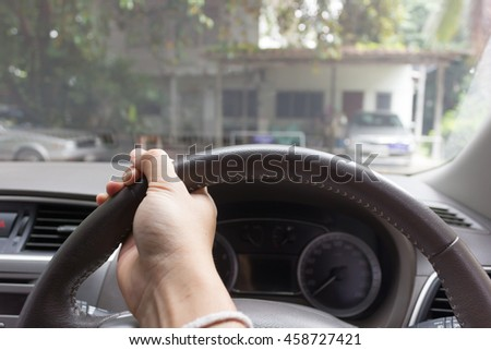 hand turning steering wheel