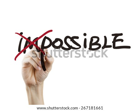 hand turning the word impossible into possible over white background - stock photo