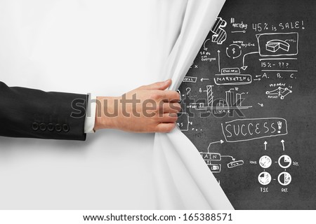 hand turns page and drawing concept on wall - stock photo