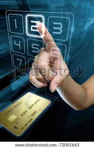 hand typing a code on a cash machine - stock photo