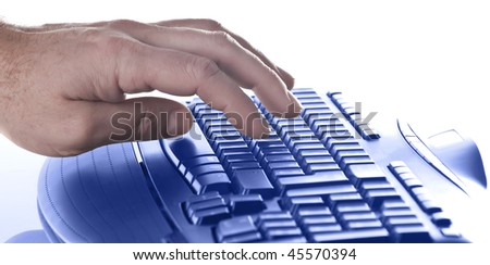 hand typing on a keyboard - stock photo
