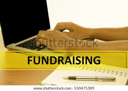 Hand Typing on keyboard with text FUNDRAISING