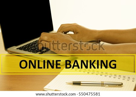 Hand Typing on keyboard with text ONLINE BANKING