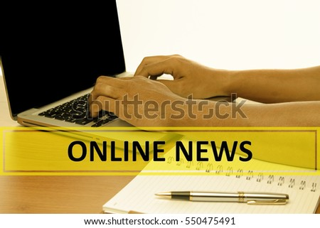 Hand Typing on keyboard with text ONLINE NEWS