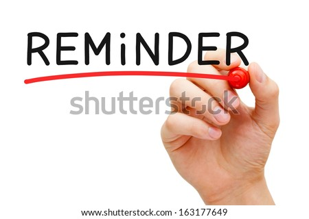 Hand underlining Reminder with red marker on transparent wipe board. - stock photo