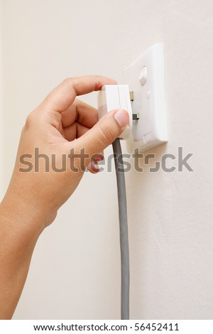 hand unplug switch socket outlet in wall
