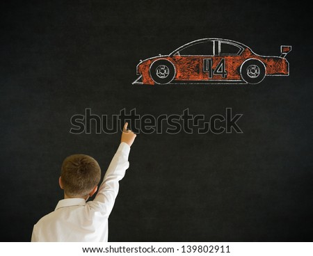 Hand up answer boy dressed up as business man with American racing fan car on blackboard background - stock photo