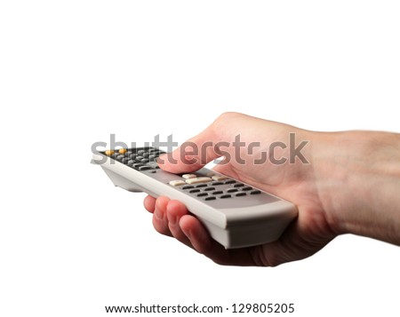 hand uses remote control - stock photo