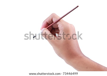 hand using paint brush