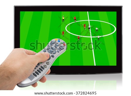Hand using remote control of watch soccer match on flat screen television against white background - stock photo