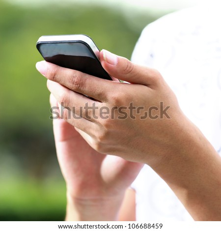 Hand using smart phone - stock photo
