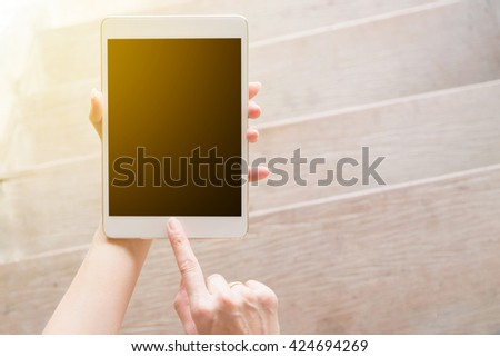 hand using tablet on top view with sunlight . Clipping path included.