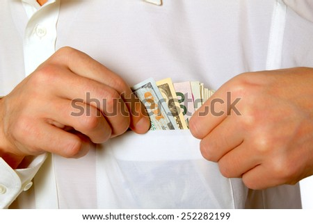 Hand uts a dollars in the pocket. - stock photo