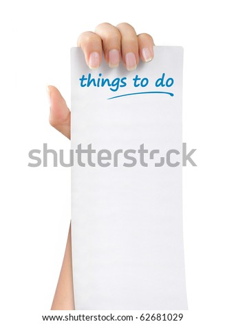 hand was holding of a things to do paper note - stock photo
