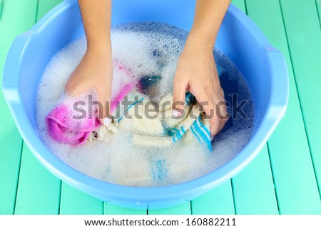 Hand wash on wooden background - stock photo