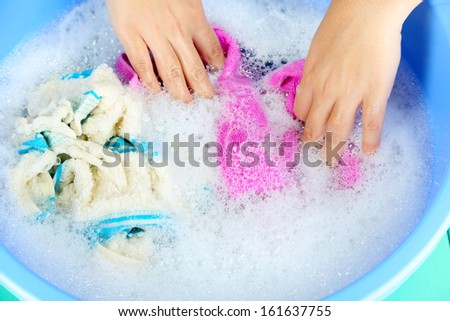 Hand wash on wooden background close-up - stock photo