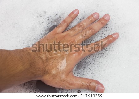 Hand washing clothes with soapy water