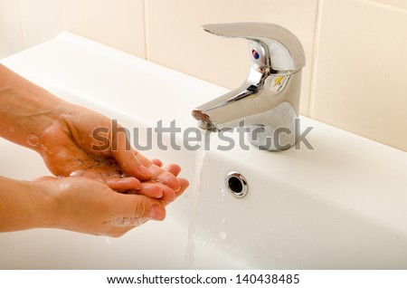hand washing under the tap closeup