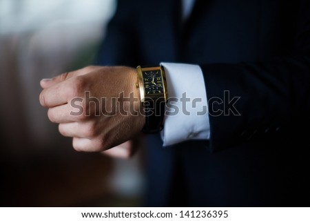 hand & watch - stock photo