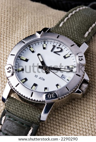Hand watch on textured background - stock photo