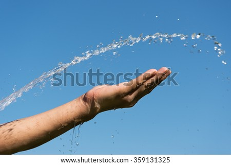 Hand, water and blue sky.