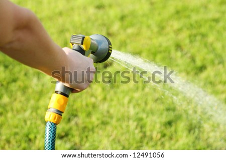 hand water garden seal hose care green - stock photo