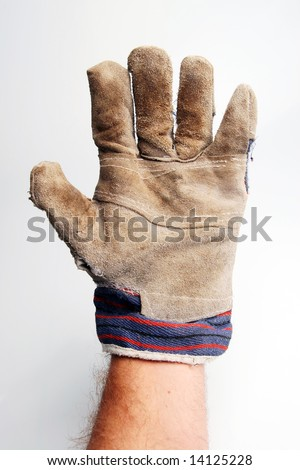 Hand wearing a used gardening glove
