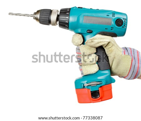 Hand wearing protective glove holding battery-powered electric drill on white background - stock photo