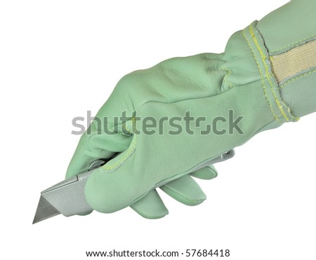 hand wearing safety glove holding a utility knife