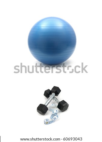 Hand weights and a fit ball isolated against a white background - stock photo