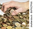 hand while gathering euro coins - stock photo