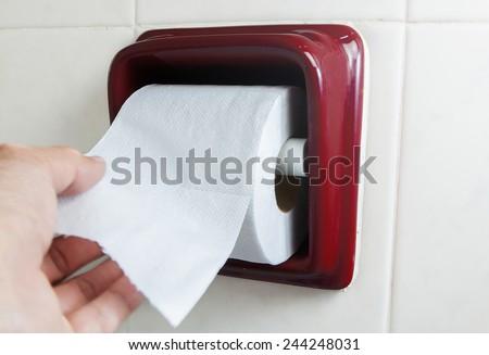 hand wite Toilet Paper  - stock photo