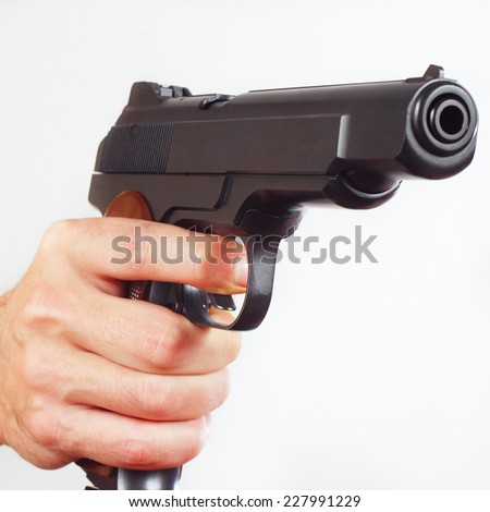 Hand with a army semi-automatic gun close up - stock photo