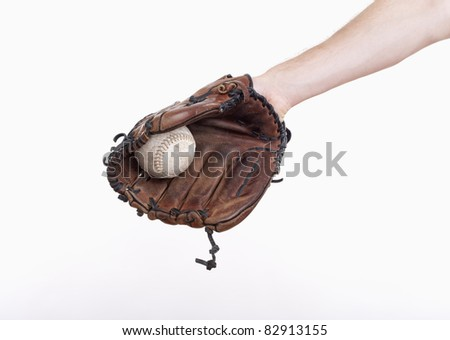 hand with a baseball glove with the ball in it - isolated on white - stock photo