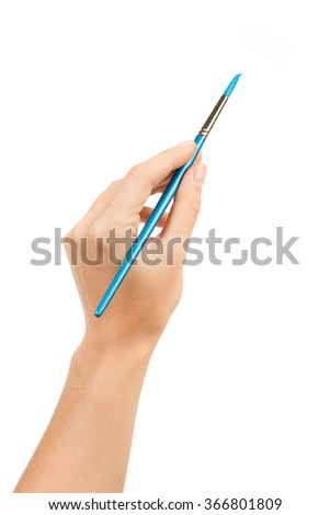 Hand with a brush isolated - stock photo