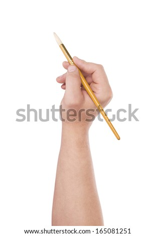 Hand with a brush isolated on white background - stock photo