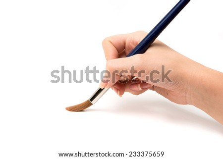 Hand with a brush. painting imitation - stock photo