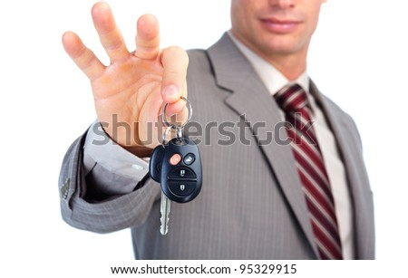 Hand with a car key. - stock photo