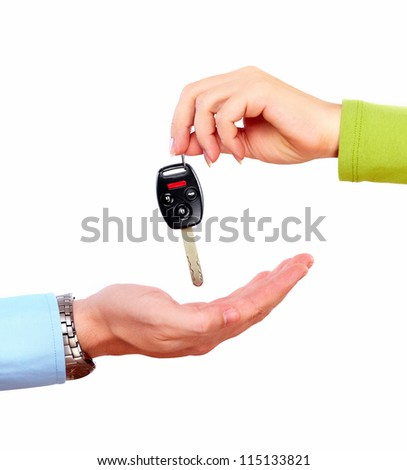 Hand with a car key. Isolated on white background. - stock photo