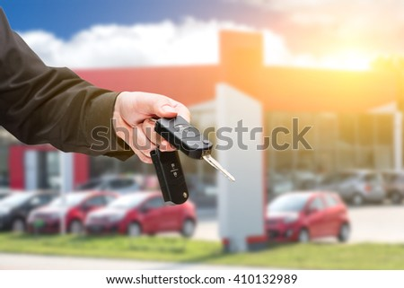 Hand with a car keys. Sunlight effect. - stock photo