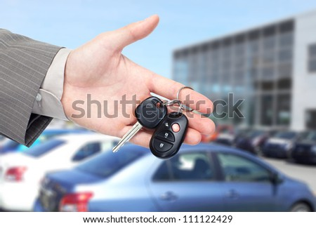 Hand with a Car keys. Transportation background. - stock photo