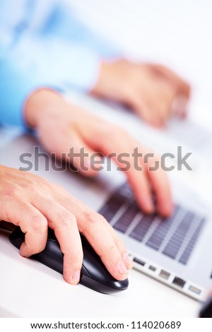 Hand with a computer mouse. Business technology background. - stock photo
