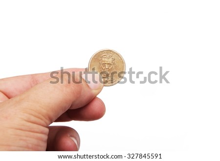 hand with a lincoln coin in a white background