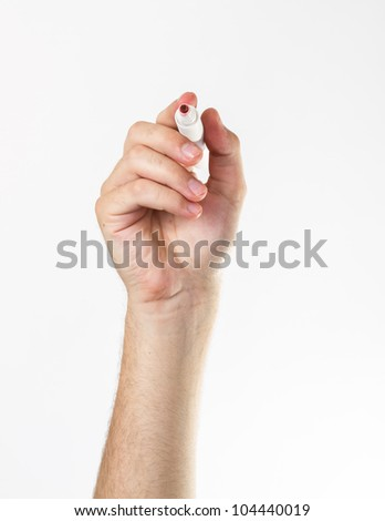 Hand with a marker isolated over white. - stock photo