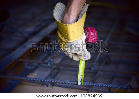 Hand with a measuring tape. - stock photo